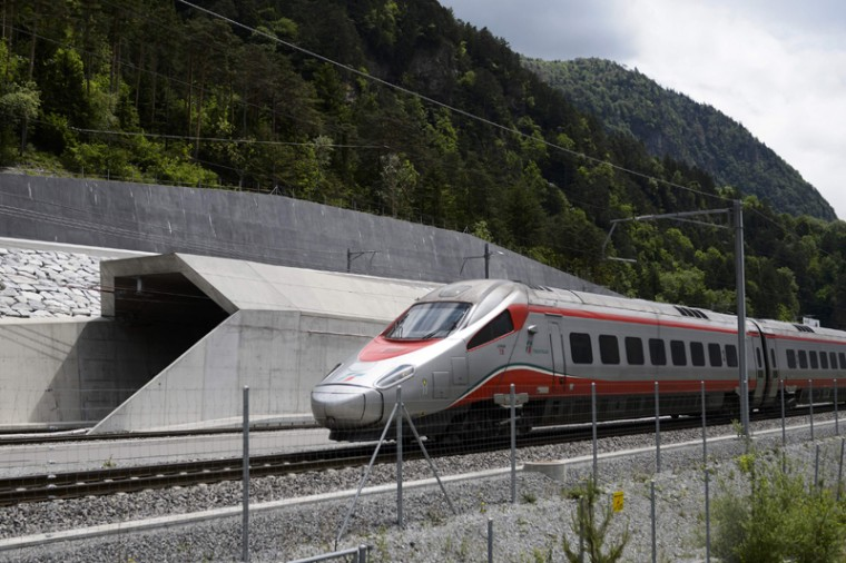 An Italian train makes its way at the north entrance of the new Gotthard Base Tunnel the world's longest train tunnel on the eve of its opening ceremony on May 31, 2016 in Erstfeld. (FABRICE COFFRINI/AFP/Getty Images)