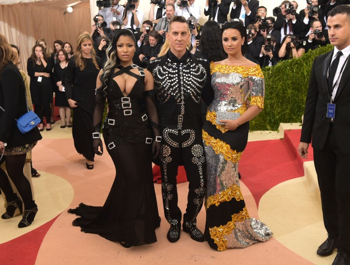 "Nicki Minaj, from left, Jeremy Scott and Demi Lovato arrive at The Metropolitan Museum of Art Costume Institute Benefit Gala, celebrating the opening of ""Manus x Machina: Fashion in an Age of Technology"" on Monday, May 2, 2016, in New York. (Photo by Charles Sykes/Invision/AP)"
