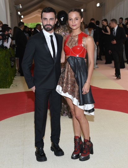 "Nicolas Ghesquiere, crestive director at Louis Vuitton, left, and actress Alicia Vikander arrive at The Metropolitan Museum of Art Costume Institute Benefit Gala, celebrating the opening of ""Manus x Machina: Fashion in an Age of Technology"" on Monday, May 2, 2016, in New York. (Photo by Evan Agostini/Invision/AP)"