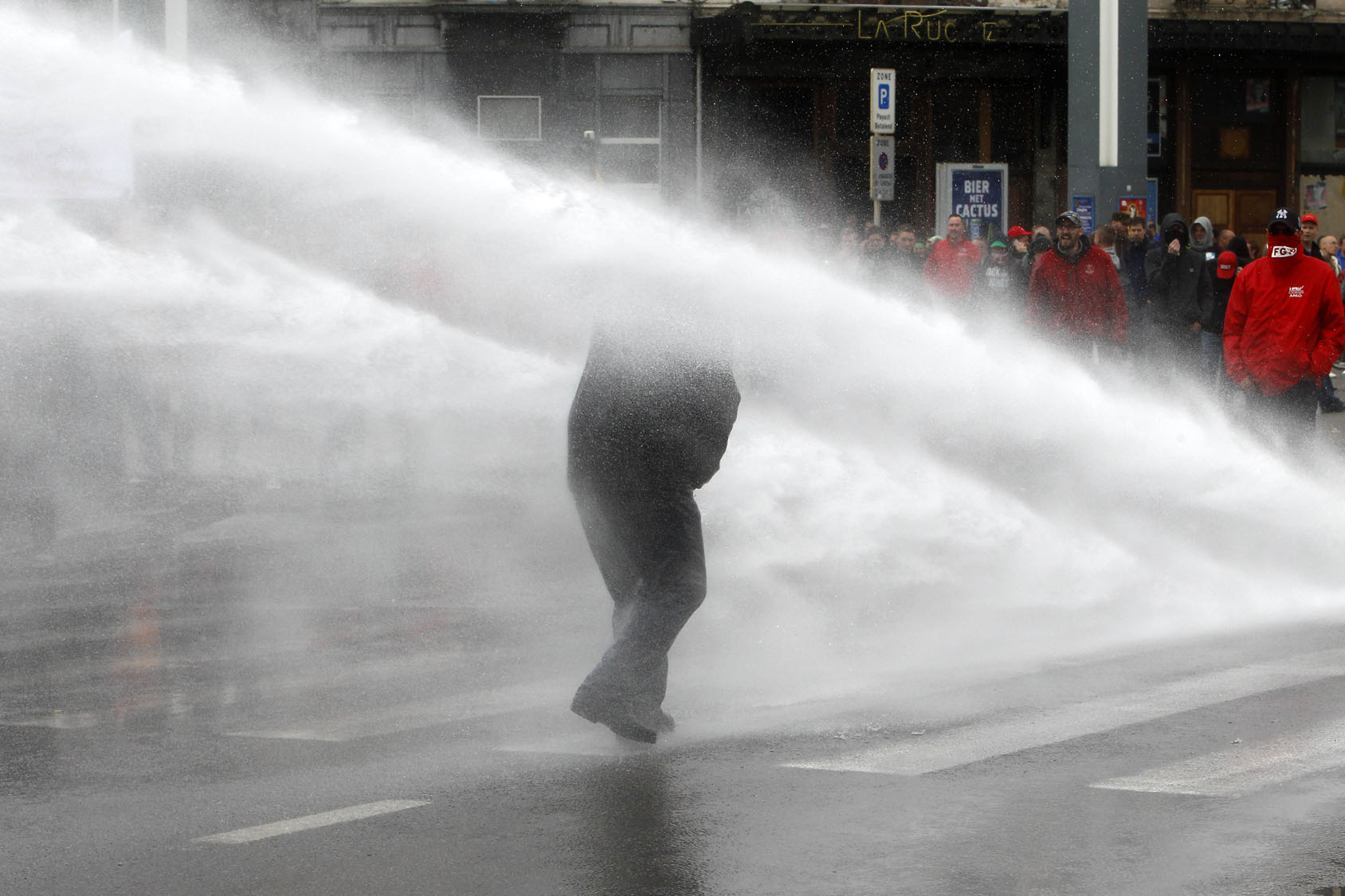 Belgian riot police clash with protesters over working regulations
