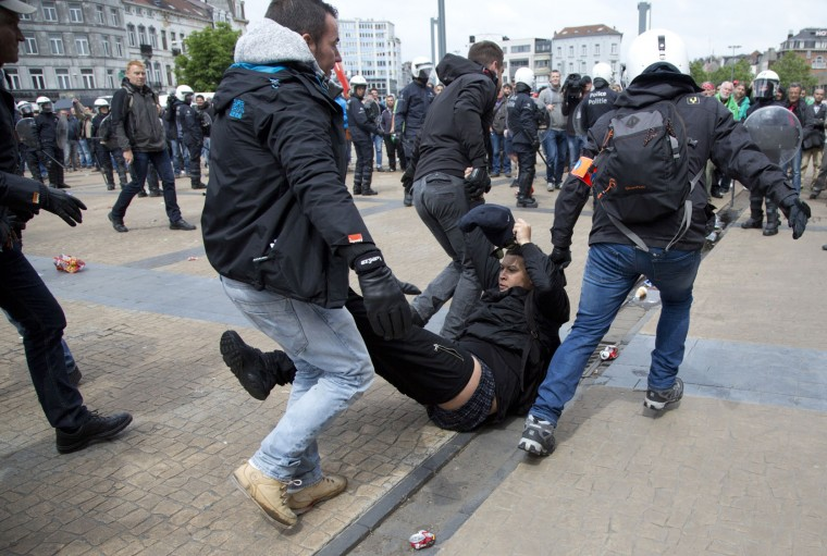 Police arrest a demonstrator during a trade union protest in Brussels on Tuesday, May 24, 2016. Tens of thousands of demonstrators marched through the center of the capital to protest the center-right government's social and economic policies which trade unions say cuts deep into the foundations of Belgium's welfare state. (AP Photo/Virginia Mayo)