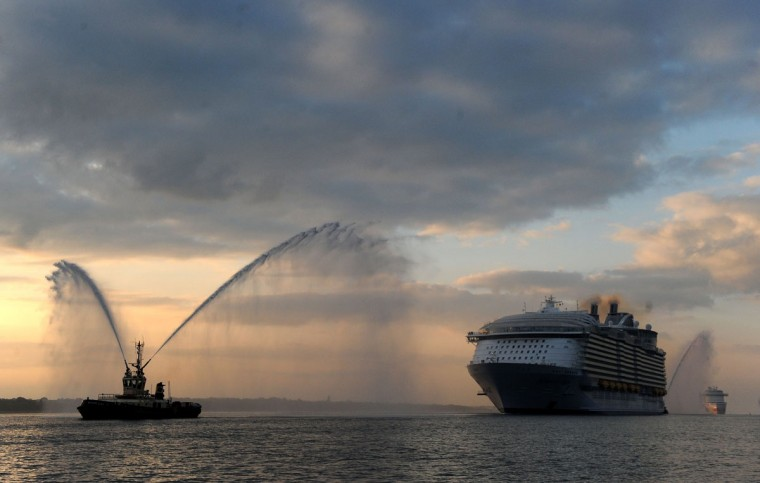 The world's largest passenger ship, Harmony of the Seas, owned by Royal Caribbean, makes her way up Southampton Water, into Southampton, England, Tuesday May 17, 2016, ahead of her maiden cruise. (Andrew Matthews/PA via AP)