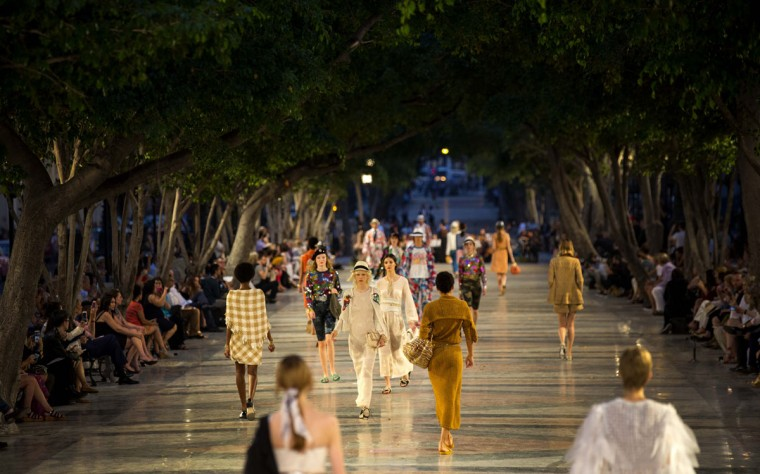 "Models wear creations from the Karl Lagerfeld ""cruise"" line for fashion house Chanel, at the Paseo del Prado street in Havana, Cuba, Tuesday, May 3, 2016. With the heart of the Cuban capital effectively privatized by an international corporation under the watchful eye of the Cuban state, the premiere of Chanel 2016/2017 ""cruise"" line offered a startling sight in a country officially dedicated to social equality and the rejection of material wealth. (AP Photo/Ramon Espinosa)"