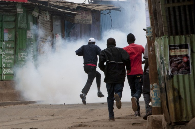 Opposition supporters, flee from exploding tear gas grenades fired by riot police, during a protest in Kibera Slums, Nairobi, Kenya Monday, May 23, 2016. The protests, held every Monday for the past four weeks, come before elections next year and are organized by Kenya's main opposition group the Coalitions for Reforms and Democracy. (AP Photo/Sayyid Azim)