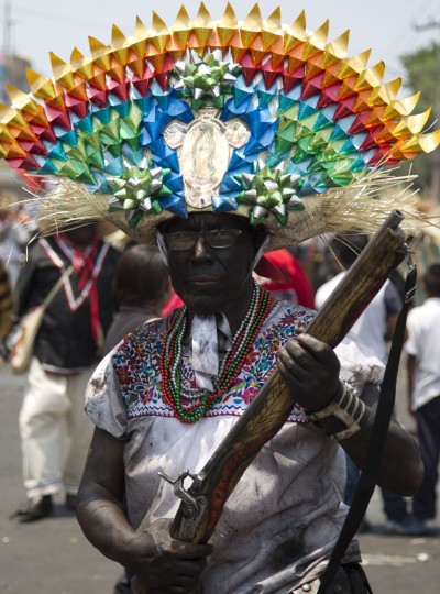 A man dressed as a revolutionary Zacapoaztla Indian soldier poses for a picture during a reenactment of the battle of Puebla between the Zacapoaztlas Indians and French army at the Cinco de Mayo celebrations, in the Penon de los Banos neighborhood of Mexico City, Wednesday, May 5, 2016. Cinco de Mayo commemorates the victory of an ill-equipped Mexican army over French troops in Puebla on May 5, 1862. (AP Photo/Eduardo Verdugo)