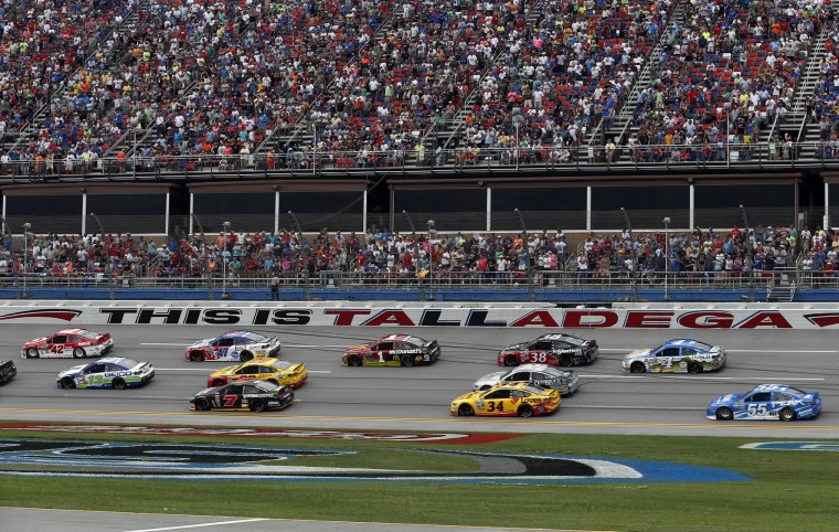Competitors drive around the track at the beginning of the NASCAR Talladega auto race at Talladega Superspeedway, Sunday, May 1, 2016, in Talladega, Ala. (AP Photo/Brynn Anderson)