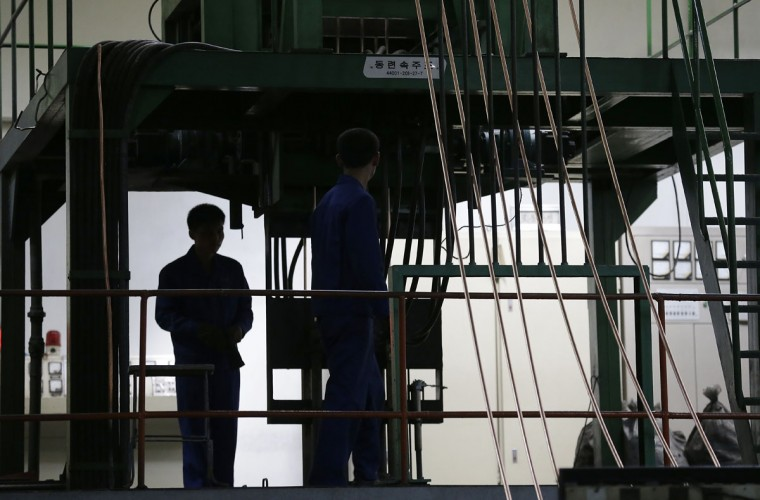North Korean workers are silhouetted at the Pyongyang 326 Electric Wire Factory, seen during a press tour on Friday, May 6, 2016, in Pyongyang, North Korea. North Korea on Friday opened the first full congress of its ruling party since 1980, a major political event intended to showcase the country's stability and unity under young leader Kim Jong Un despite international criticism and tough new sanctions over the North's recent nuclear test and a slew of missile launches. (AP Photo/Wong Maye-E)