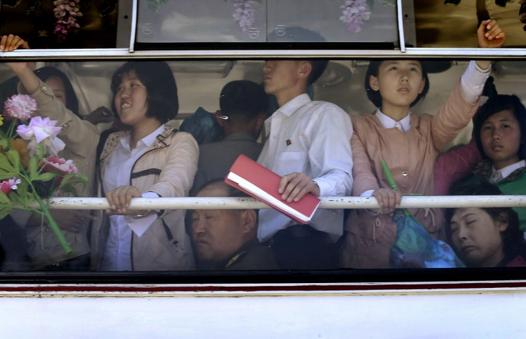 North Koreans, adults and youths, ride on an electric trolley bus Saturday, May 7, 2016 in Pyongyang, North Korea. North Korean leader Kim Jong Un hailed his country's recent nuclear test to uproarious applause as he convened the first full congress of its ruling party since 1980, an event intended to showcase the North's stability and unity in the face of tough international sanctions and deepening isolation. (AP Photo/Wong Maye-E)