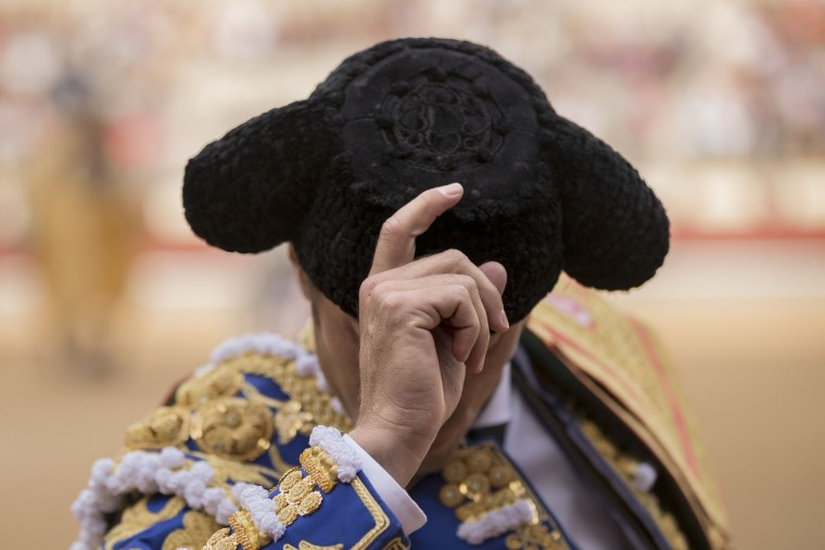 Spanish bullfighter Manuel Escribano salutes during the ritual entrance to the arena before a bullfight at the Las Ventas bullring in Madrid, Tuesday, May 17, 2016. (AP Photo/Daniel Ochoa de Olza)