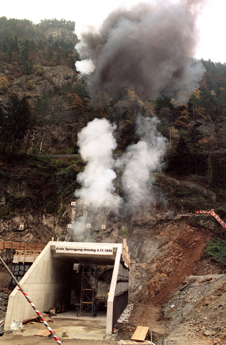 In this Nov. 4, 1999, file photo, smoke billows after the first blasting operation for the NEAT Gotthard Base Tunnel in Silenen, Switzerland. (Sigi Tischler/Keystone via AP, file)