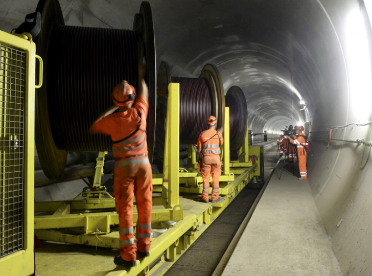 In this Oct. 31, 2013, file photo, construction workers are busy in the NEAT Gotthard Base Tunnel between Biasca and Amsteg, Switzerland. (Karl Mathis/Keystone via AP, file)