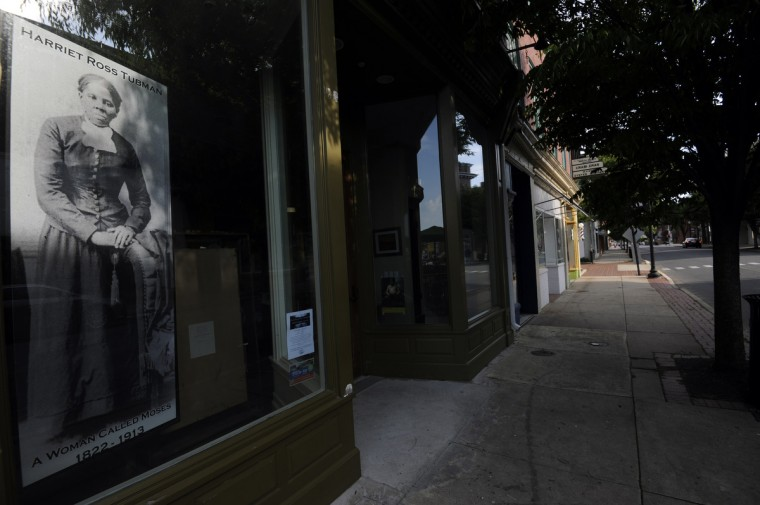 A poster of Harriet Ross Tubman dominates a window of the Harriet Tubman Museum and Educational Center on Race Street in Cambridge. (Kim Hairston/Baltimore Sun)
