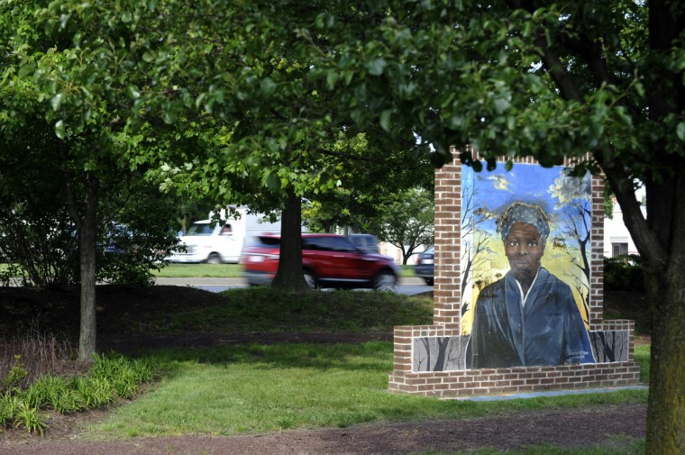 A mural of Harriet Tubman painted by one of her descendants, Charles E.T. Ross, is the centerpiece of the Harriet Tubman Memorial Garden alongside US 50 in Cambridge. (Kim Hairston/Baltimore Sun)