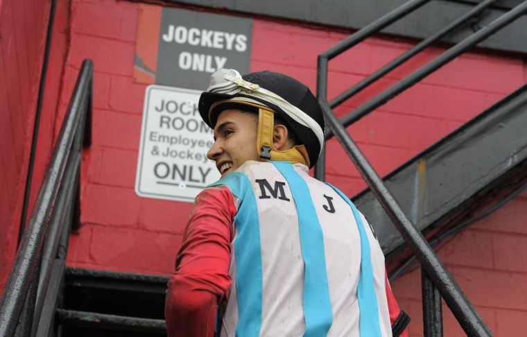 Nik Juarez a third generation jockey smiles after winning aboard Scorpion Aly at Pimlico race course. (Lloyd Fox/Baltimore Sun)