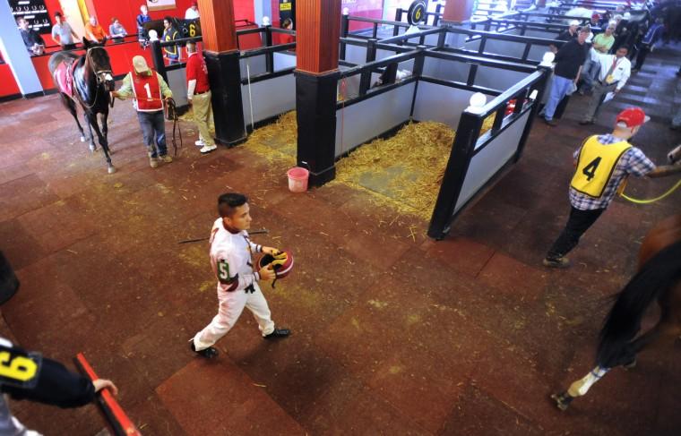 Nik Juarez walks through the paddock prior to a race at Pimlico. (Lloyd Fox/Baltimore Sun)