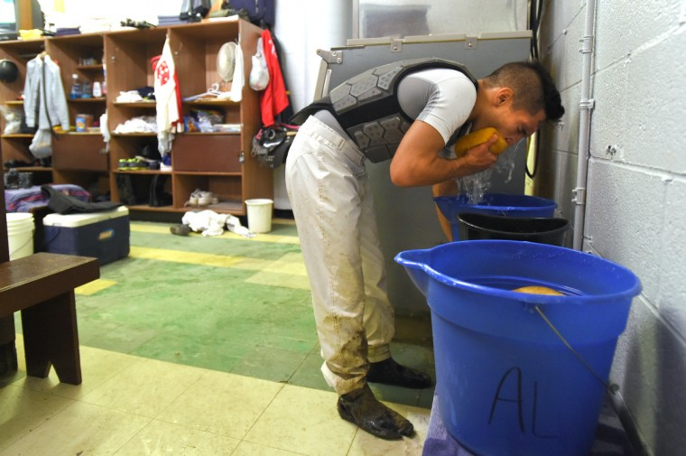 Nik Juarez washes his face after a race at Pimlico.  (Lloyd Fox/Baltimore Sun)