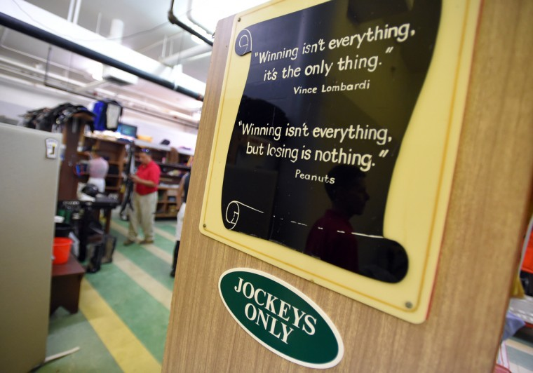 A sign in jockey's room reminds them what they are there for. (Lloyd Fox/Baltimore Sun)