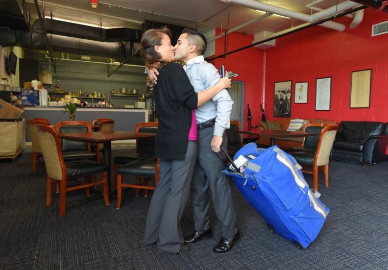 Nik Juarez kisses his fiance, Kara Evans, before leaving Pimlico to head to Monmouth Park to ride for the weekend.  (Lloyd Fox/Baltimore Sun)