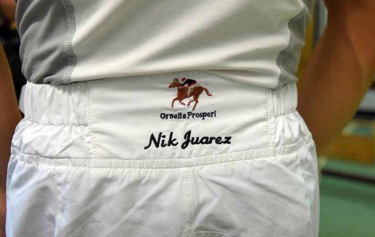 Nik Juarez a third generation jockey races at Pimlico race course.     (Lloyd Fox/Baltimore Sun)