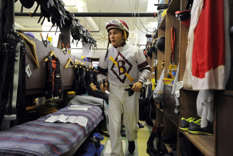 Nik Juarez a third generation jockey gets ready for a race at Pimlico race course.     (Lloyd Fox/Baltimore Sun)