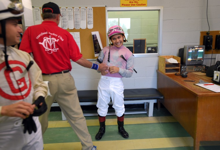 A valet jokes with Nik before one of his races at Pimlico race course.      (Lloyd Fox/Baltimore Sun)