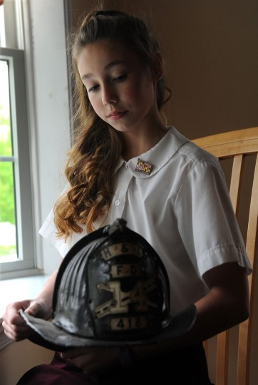 Olivia Lockett, 12, is a 6th grader at St. Stephen School in Kingsville. She will be singing the National Anthem at the Fallen Heroes Memorial ceremony on May 6. She is the great granddaughter of Baltimore city firefighter James Gallagher, who was killed in the line of duty in 1961. He will be honored at the ceremony. (Barbara Haddock Taylor/Baltimore Sun)