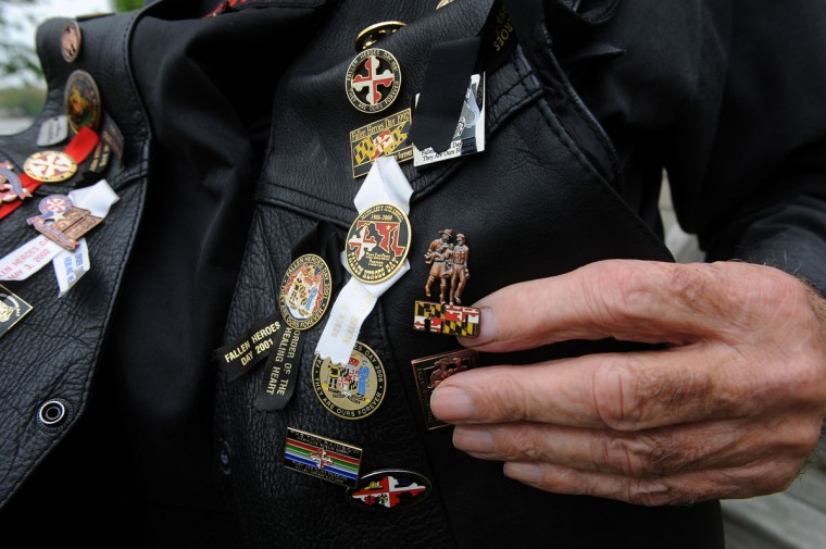 William Renshaw has saved every pin from Fallen Heroes Day in honor of his brother-in-law, Henry Rayner Jr., a Baltimore County firefighter who was killed in the line of duty and was honored in the first Fallen Heroes ceremony in 1986. (Barbara Haddock Taylor/Baltimore Sun)
