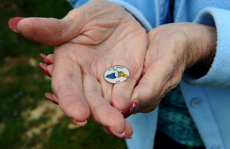 Evelyn Rayner, mother of Henry Rayner, who was a Baltimore County firefighter killed in the line of duty in 1986, holds his Fallen Heroes pin. Henry was honored in the first Fallen Heroes ceremony. (Barbara Haddock Taylor/Baltimore Sun)
