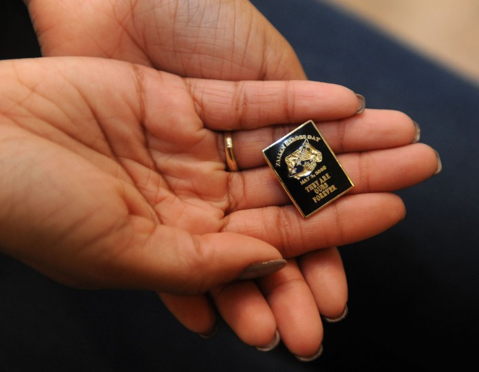 Casey Brooks, 25, who is the daughter of Corporal Courtney Brooks, holds his Fallen Heroes Day pin. Her father was a 13-year veteran of the Maryland Transportation Authority Police who was killed in the line of duty on New Year's Eve in 2008. This is the commemorative pin that was made in his honor for the Fallen Heroes Ceremony. She was 17 when he died. (Barbara Haddock Taylor/Baltimore Sun)