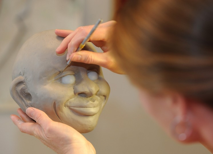 Tiffany Lange, founder of Charm City Puppets, works on sculpting a figure called Sam at her studio in the Creative Alliance at the Patterson. Sam will be part of a 3-puppet educational team who will work with children facing health challenges. (Barbara Haddock Taylor/Baltimore Sun)