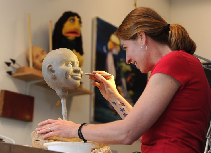 Tiffany Lange, founder of Charm City Puppets, works on sculpting a figure called Sam  at her studio in the Creative Alliance at the Patterson. Sam will be part of a team of video-based puppet educators for children who are facing health challenges.  (Barbara Haddock Taylor/Baltimore Sun)