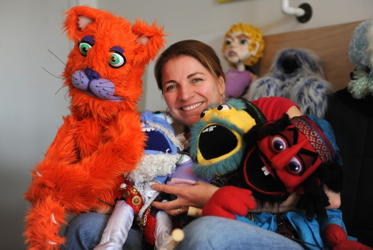 Tiffany Lange, founder of Charm City Puppets, poses with some of her creations at her studio in the Creative Alliance at the Patterson. (Barbara Haddock Taylor/Baltimore Sun)
