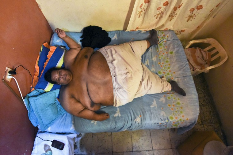 Oscar Vasquez Morales, 44, rests is in his bed on March 19, 2016, in Palmira, Colombia. Vasquez, who weighs about 880 pounds and is considered the fattest man in the country, is expected to lose 660 kilos in the next 3 or 4 years due to a medical treatment. (LUIS ROBAYO/AFP/Getty Images)
