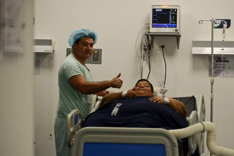 Oscar Vasquez Morales, 44, considered the most obese male in Colombia, gestures next to bariatric surgeon Juan del Castillo on May 16, 2016 at the clinic where he will get a gastric balloon implanted. The procedure is expected to reduce his weight substantially. (LUIS ROBAYO/AFP/Getty Images)