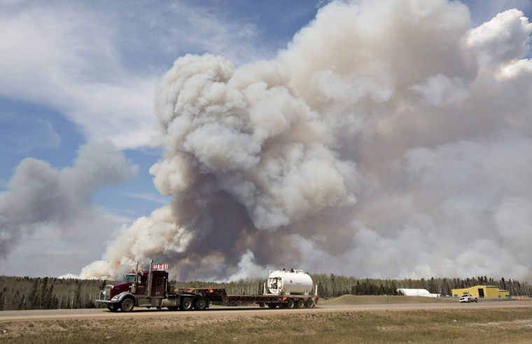 A wildfire rages through Fort McMurray, Alberta, on Wednesday, May 4, 2016. The raging wildfire emptied Canada's main oil sands city, destroying entire neighborhoods of Fort McMurray, where officials warned Wednesday that all efforts to suppress the fire have failed. (Jason Franson /The Canadian Press via AP)