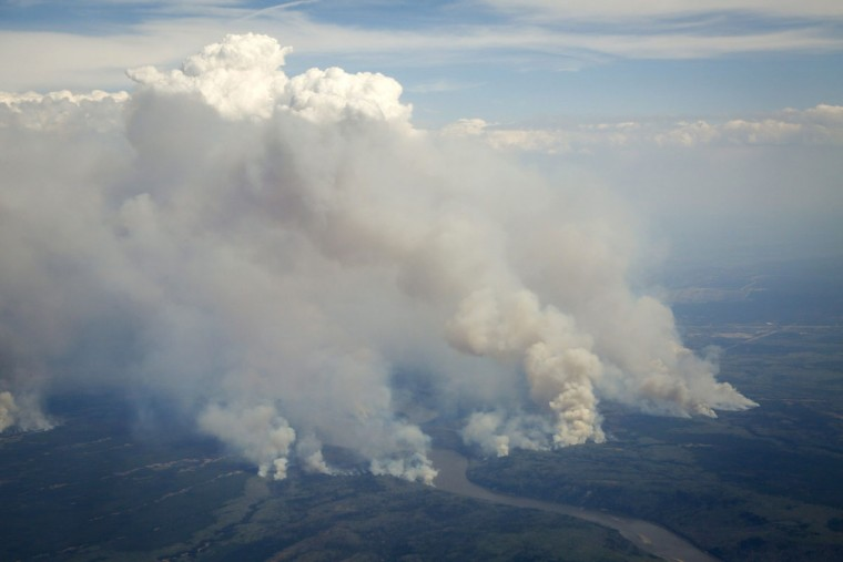 Wildfires burn in and around Fort McMurray, Alberta, Wednesday, May 4, 2016. The raging wildfire emptied Canada's main oil sands city, destroying entire neighborhoods of Fort McMurray, where officials warned Wednesday that all efforts to suppress the fire have failed. (Jeff McIntosh/The Canadian Press via AP)