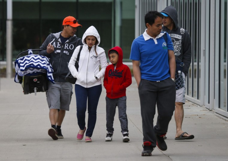 Evacuees from the Fort McMurray wildfires arrive at the evacuation center in Edmonton, Canada on Thursday, May 5, 2016. Raging wildfires in the Canadian province of Alberta have moved south, forcing three more communities to evacuate and an emergency operations center to move again , taking it far from the devastated oil sands city of Fort McMurray. (Jeff McIntosh/The Canadian Press via AP)