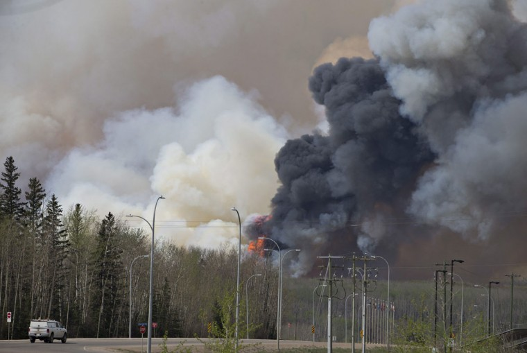 A wildfire rages through Fort McMurray, Alberta on Wednesday May 4, 2016. The raging wildfire emptied Canada's main oil sands city, destroying entire neighborhoods of Fort McMurray, where officials warned Wednesday that all efforts to suppress the fire have failed. (Jason Franson /The Canadian Press via AP)