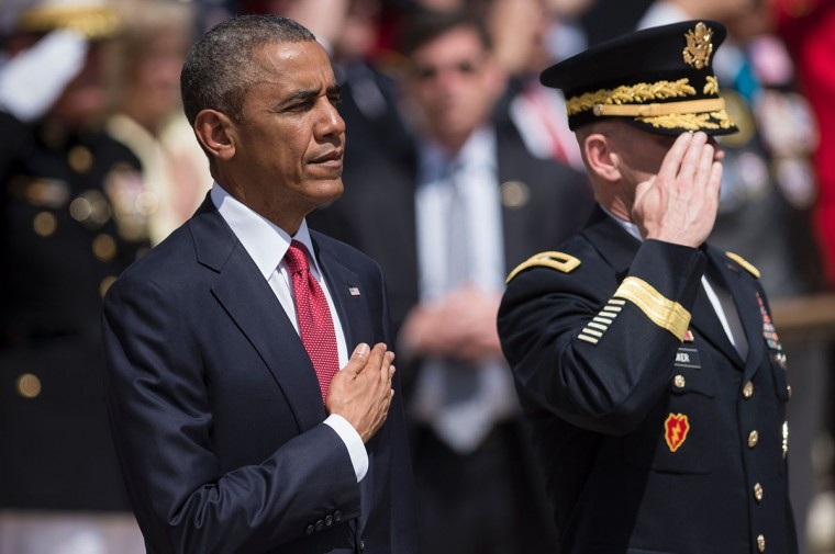 President Barack Obama and Major General Bradley A. Becker, Commander of the Military District of Washington, listen to the US national anthem before placing a wreath at the Tomb of the Unknowns to honor Memorial Day at Arlington National Cemetery on May 30, 2016 in Arlington, Virginia. (BRENDAN SMIALOWSKI/AFP/Getty Images)