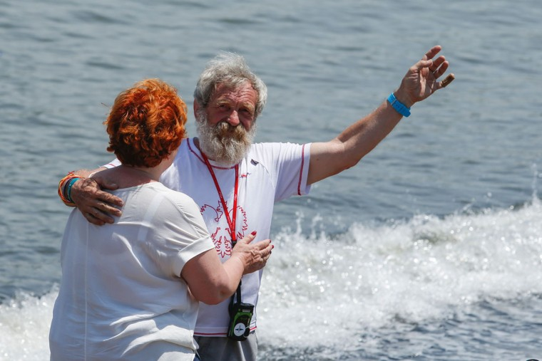 "Polish kayaker Aleksander Doba waves to the crowd as he hugs his wife Gabriela Doba before the beginning of his transatlantic kayak adventure from New York to Lisbon on May 29, 2016 in New York. Doba says this will be his toughest challenge yet, but that he feels like a young man and ""will not pretend to be old."" (EDUARDO MUNOZ ALVAREZ/AFP/Getty Images)"
