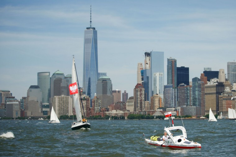 "The One World Trade center is seen at the background as Polish kayaker Aleksander Doba sails during the start of his translatlantic kayak adventure from New York to Lisbon on May 29, 2016 in New York. Doba says this will be his toughest challenge yet, but that he feels like a young man and ""will not pretend to be old."" (EDUARDO MUNOZ ALVAREZ/AFP/Getty Images)"