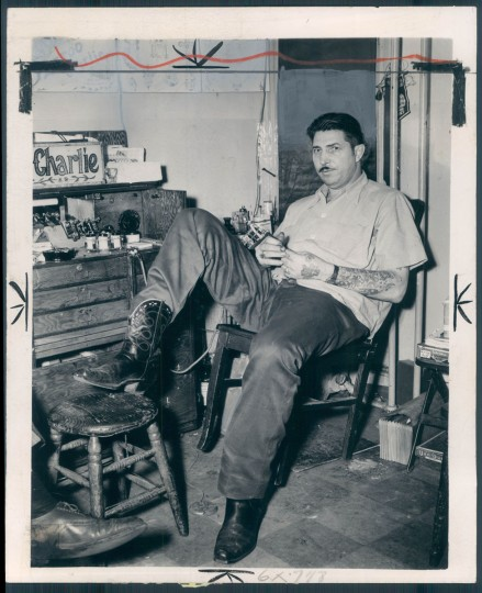 """Tattoo Charlie"" Geizer in 1946. The caption that ran with this story says ""Most of his tatto business is now devoted to covering up sweetheart initials which no longer symbolize warborn romances."" (Baltimore Sun)"
