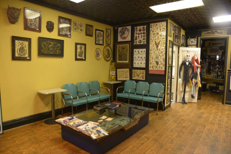 The waiting area at Tattoo Charlie's is adorned with designs -- many of them antique. The shop's current owners took over in 2008, and embraced the place's long history. (Christina Tkacik/Baltimore Sun)