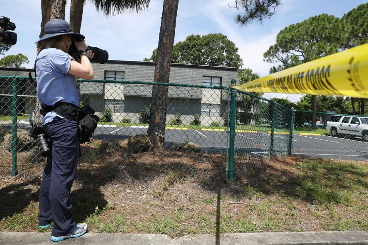 FORT PIERCE, FL - JUNE 12: Police tape marks off the entrance to the apartment building where shooting suspect Omar Mateen is believed to have lived on June 12, 2016 in Fort Pierce, Florida. The mass shooting at Pulse nightclub in Orlando, Florida killed at least 50 people and injured 53 others in what is the deadliest mass shooting in the country's history. (Photo by Joe Raedle/Getty Images)
