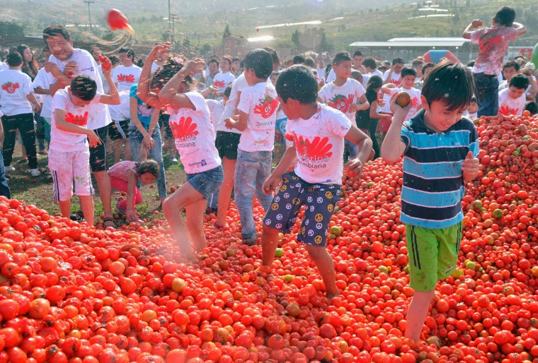 "Children participate in the 10th annual tomato fight festival, known as ""tomatina"", in Sutamarchan, Boyaca department, Colombia, on June 5, 2016. (GUILLERMO LEGARIA/AFP/Getty Images)"