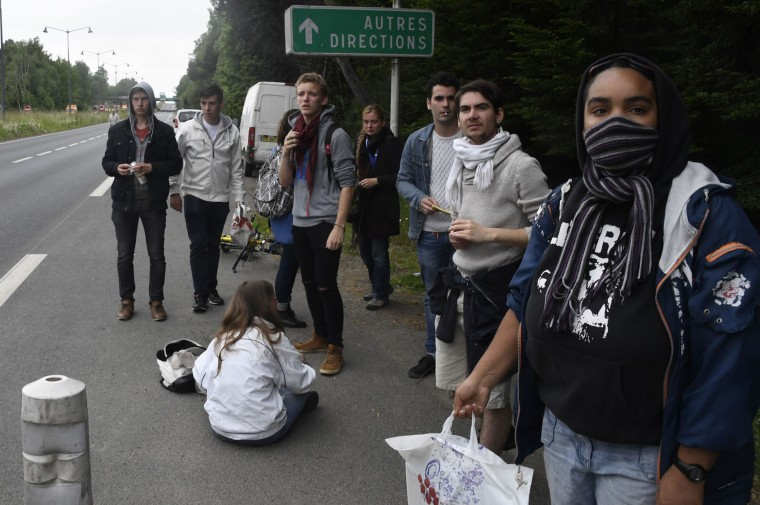 Protesters surround an injured woman after police clashed with protesters during a rally against the government's labour market reforms in Rennes, northwestern France, on June 2, 2016. Thousands took to the streets across the country on Thursday in the latest demonstrations against the labour law reforms, which the government says are designed to make France more business-friendly. In Rennes, the police charged the protesters with the help of vehicles, leaving several injured. (Damien Meyer/AFP/Getty Images)