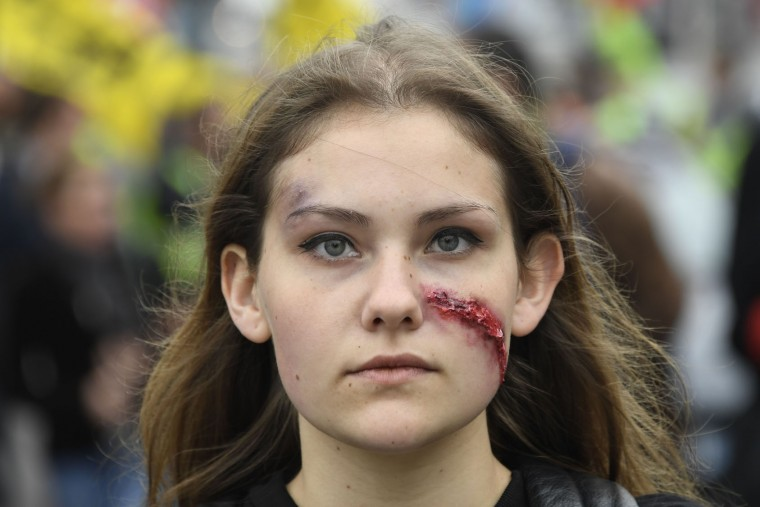 A girl with a makeup scar looks on as she protests against the government's labour market reforms in Rennes, northwestern France, on June 2, 2016. Thousands took to the streets across the country on Thursday in the latest demonstrations against the labour law reforms, which the government says are designed to make France more business-friendly. (Damien Meyer/AFP/Getty Images)