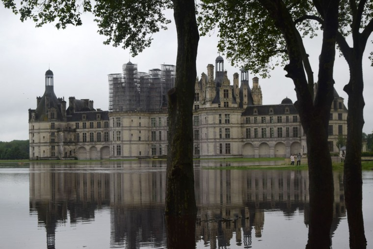 This handout picture released by the Domaine national de Chambord shows a flooded area in front of the Chateau de Chambord (the Castle of Chambord) on June 1, 2016 in Chambord as torrential downpours have lashed parts of northern Europe in recent days, leaving four dead in Germany. In Paris, the river Seine burst over walkways, while in northern and central France, homes and cars were wrecked as flooding left several towns and villages under a metre or more of water. More than 80 roads across France had to be closed. (AFP PHOTO / Domaine national de Chambord / A. Leboutey)