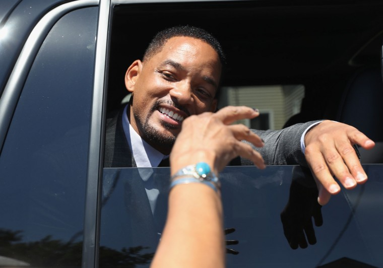 Actor Will Smith greets the public while riding in the funeral procession of Muhammad Ali on June 10, 2016 in Louisville, Kentucky. Smith played the boxing legend in the film 'Ali' in 2001 and was a pall-bearer at Ali's funeral. The funeral possession winded through Louisville, preceding a memorial service and giving the public an opportunity to honor the four-time world heavyweight boxing champion, who died on June 3 at age 74, (Photo by John Moore/Getty Images)