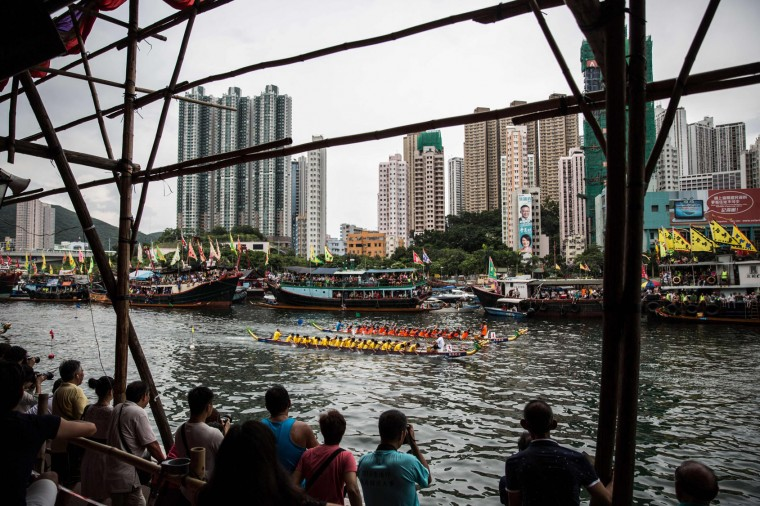 Spectators watch from the stands as teams compete in dragon boat races held to celebrate the Tuen Ng festival in Hong Kong on June 9, 2016. (Anthony Wallace/AFP/Getty Images)